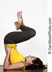 gym exercise - pretty girl arching her back like a bridge,...