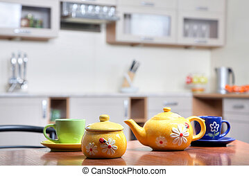 Teacups - An image of teapot and green and blue teacups