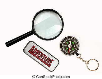 Discovery - An image of magnifier and compass on background