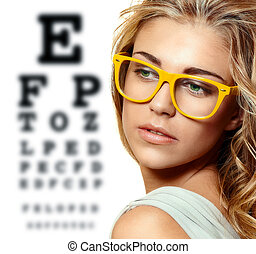 beautiful blond woman with yellow trendy glasses on the...