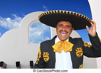 Charro mariachi portrait singing in mexican house - Charro...