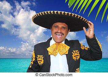 Charro mariachi singing shout in Mexico beach