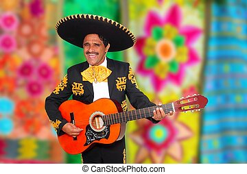 Charro Mariachi playing guitar serape poncho background