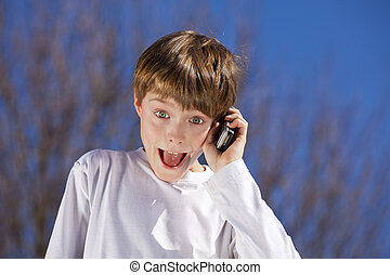 laughing boy with a cell phone