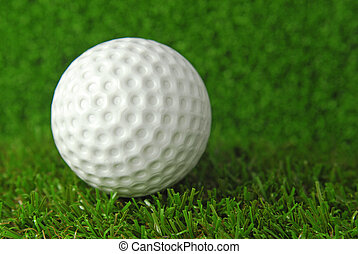 golf ball on the green grass turf