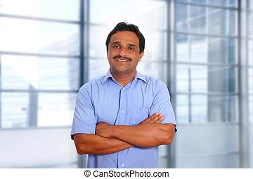 Indian latin businessman blue shirt in modern office...