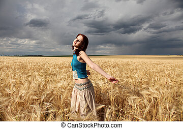 beautiful girl at wheat field in rainy day