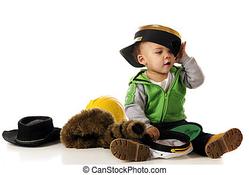 Hat Lover - An adorable mixed-race baby trying on a many...