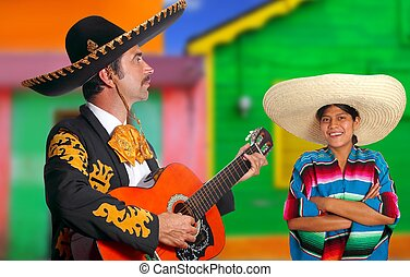Mexican mariachi charro man and poncho Mexico girl colorful...