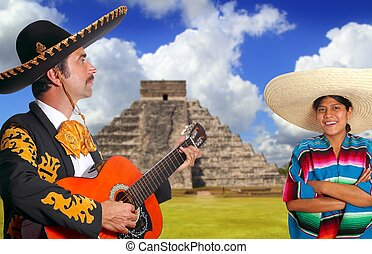 Mexican mariachi charro man and poncho Mexico girl Chichen...