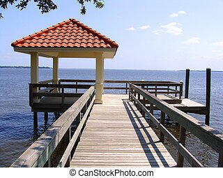 A Dock on a Wide River - A dock and gazebo with tile roof on...