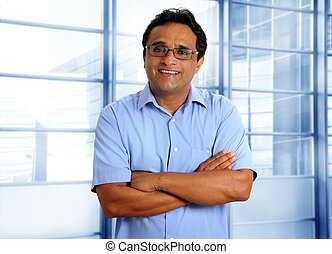 indian latin businessman glasses blue shirt in office
