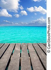 Caribbean wood pier with turquoise aqua sea blue sky Mayan...