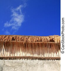 Palapa sunroof detail wooden sticks wall on blue sky