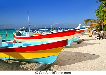 colorful tropical boats beached in sand Isla Mujeres -...