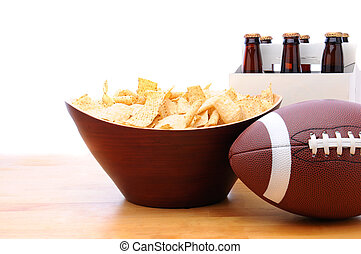 Chips, football and Six Pack of Beer