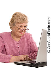 The elderly woman at the computer