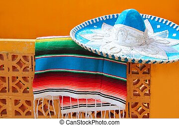 charro mariachi blue mexican hat serape poncho over orange...
