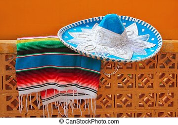 charro mariachi blue mexican hat serape poncho over orange...
