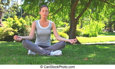 Woman doing the lotus position - Relaxed woman doing the...