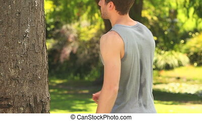 Man sweating after sports in a park