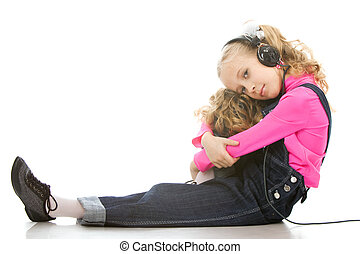 Little girl listening music - Young beautiful girl listen to...