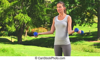 Woman doing musculation exercises - Cute woman doing...