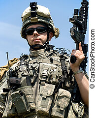 US soldier in camouflage uniform with his rifle