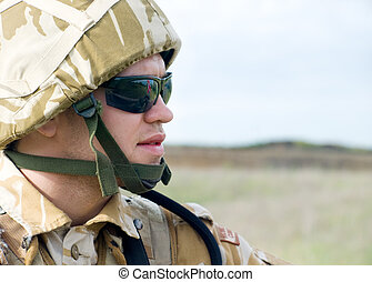 British soldier with the reflection of UK flag in glasses...