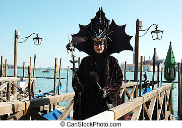 Black bat mask at Venice carnival - Lady dressed in costume...