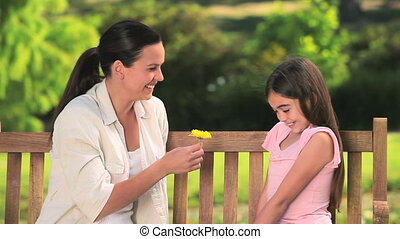 Mother and daughter with a flower