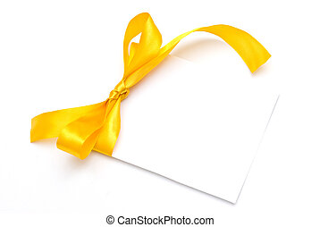 Blank gift tag tied with a bow of yellow satin ribbon.