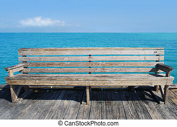 Beach Bench - bench on pier over water