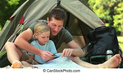 Dad teaching son how to read a map