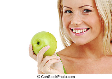 woman eat green apple - blond woman eat green apple on white