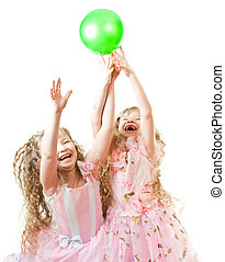 Twin sisters playing - Two twin sisters in beautiful rose...