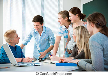 high school students - young students studying together in a...