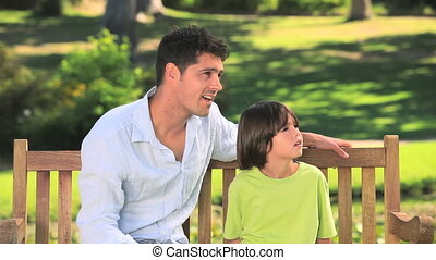 Father and son chatting outdoors - Father and son happy...