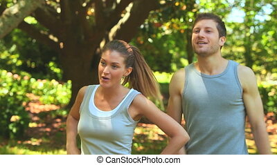 Joggers stopping to rest - Athletic couple taking a rest...
