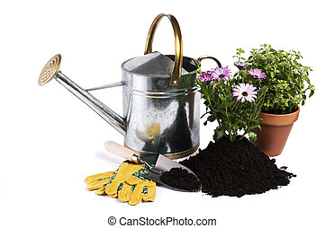 Gardening - Watering can with flower and gardening tools...