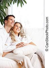 Love couple - Young love couple smiling in the comfortable...