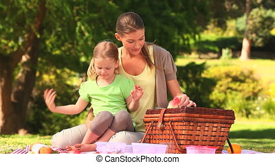 Mom and daughter eating watermelon - Mother with her...