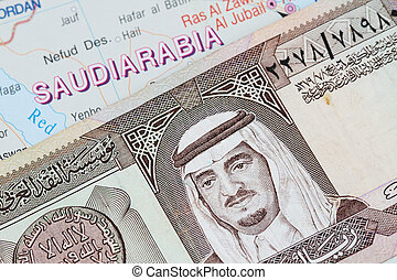 Saudi Arabia Currency and map of saudi arabia
