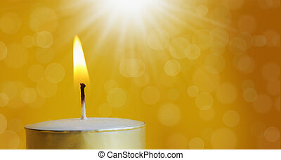 one burning candle with bright white light and orbs