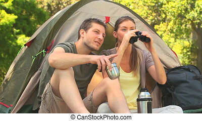 Attractive couple using binoculars