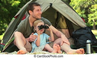 Boy looking through binoculars - Small boy looking through...