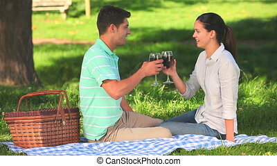 Couple drinking red wine outdoors - Attractive couple...