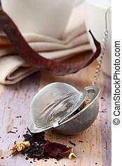tea strainer with a black tea - tea strainer with a fragrant...
