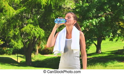 Woman drinking water after sports - Woman drinking water and...