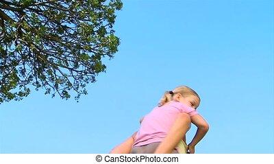 Woman giving daughter a piggy back - Woman giving a piggy...